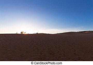Red sand dunes in Mui Ne village on sunset, Vietnam - Red...