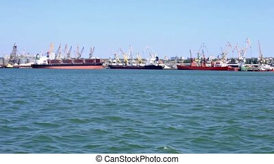 Floating along the cargo port - Cargo port with cranes and...