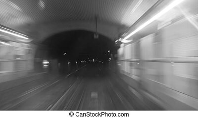 Monochrome timelapse of subway train on the route - Black...