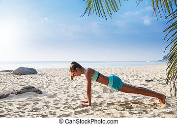 Young pretty slim brunette woman practise yoga pose on...