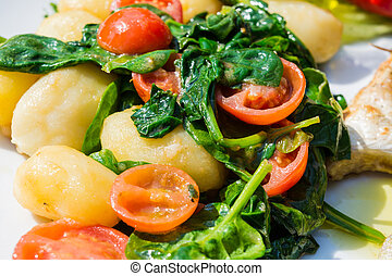 Potatoes with Spinach and Tomatoes.