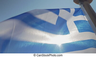 Close up Greece flag waving against sun - Greece flag with...