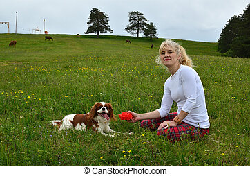 Cavalier King Charles Spaniel Dog and Woman in the Countryside