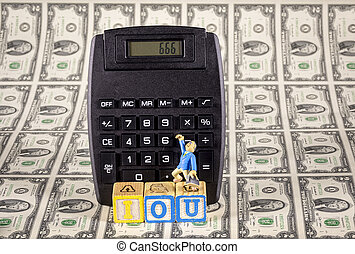 IOU 666 on a calculator with money and man - Figure of a man...
