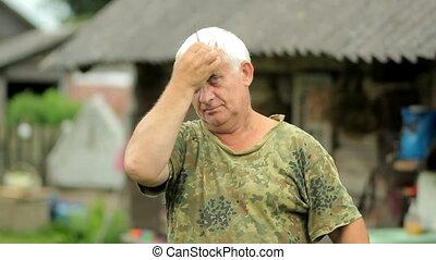 Senior man haircut just and straightens hair. Gray hair...