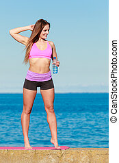 Woman with water after workout