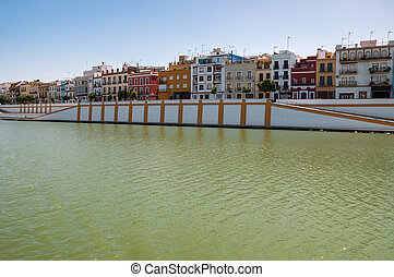 Betis street, Triana district of Seville seen from the river...