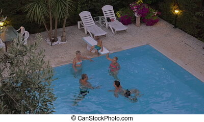 Family bathing in the swimming pool - High angle shot of...