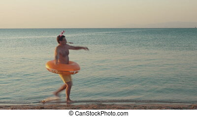 Funny man dancing on the beach