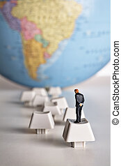 Technology leads to world knowledge - Business figurine...