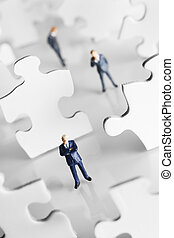 Putting the pieces together - Businessman figurine...