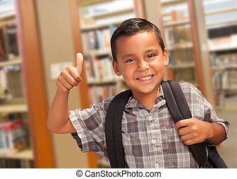 Hispanic Student Boy with Thumbs Up in the Library -...