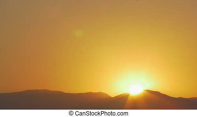 Sun rising from behind the hills - Nature scene of sunrise...