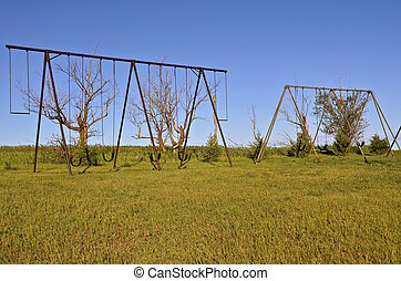 Old swing sets - Several sets of old time swing sets in a...