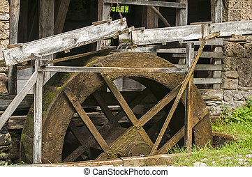 Wooden mill wheel - Old retro wooden mill wheel powered by...