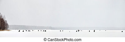 fishermans on frozen lake surface