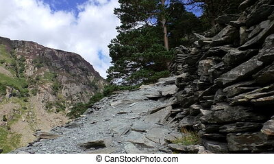 Climbing up rocky mountain - Low angle POV handheld shot of...