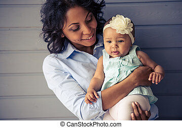 Mom and baby - Portrait of beautiful young Afro American...