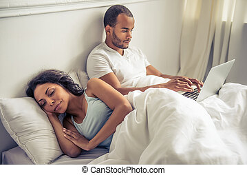 Afro American couple - Handsome young Afro American man is...