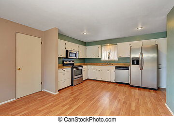 Remodeled kitchen with stainless steel appliances.
