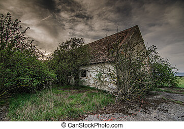 old house with rain clouds - old house with dark rain clouds