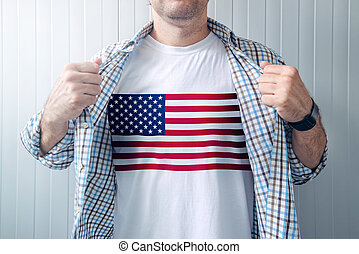 American patriot wearing white shirt with USA flag print,...