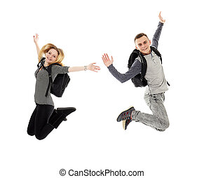 Students with backpacks jumping for joy - Couple of teenage...