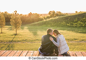 Couple in the autumn park. Romantic couple relaxing on the...