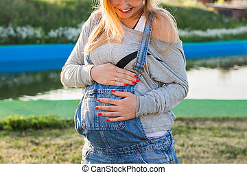 Young pregnant woman in nature