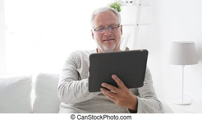 senior man with tablet pc at home 9 - technology, people and...