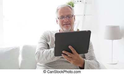 senior man with tablet pc at home 115 - technology, people...