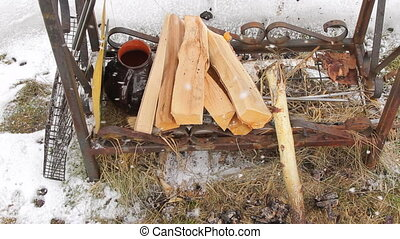 Firewood for brazier - Firewood and grill grate on the...