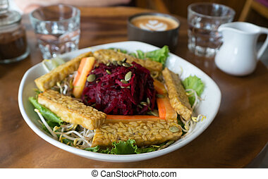 Tempeh salad and coffee. - Salad with fried Tempeh, beetroot...