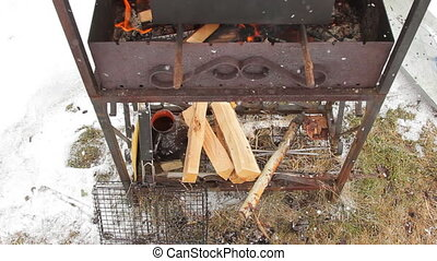 Brazier with flame and firewood - Smoker box standing on...