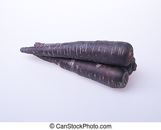 carrot or black carrot on a background. - carrot or black...