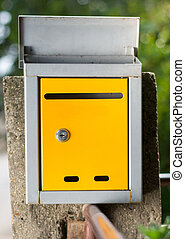 Open mailbox in front of the house, waiting for letters