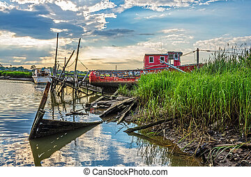Old Red Boat - An old red fishing boat and broken docks...