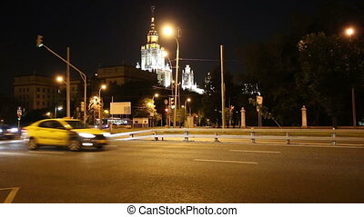 Traffic of cars in Moscow city center at night, Russia