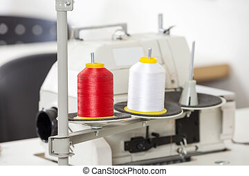 Thread Spools In Sewing Factory - Thread spools and sewing...