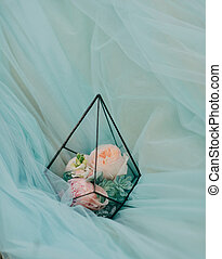 bouquet of pink roses - on on the blue fabric in a glass box...