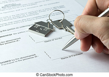 Sale and purchase agreement - Man signing sale and purchase...