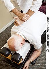 Chiropractic Medicine - Closeup of chiropractors hands...