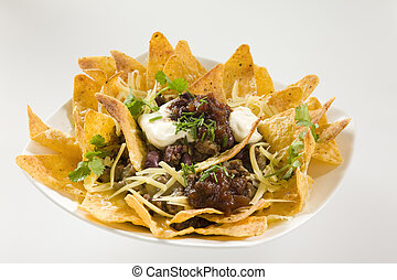 Tasty Crunchy Nachos served with sour cream