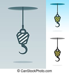 A heavy duty hook suspended on a cable hanging through a...