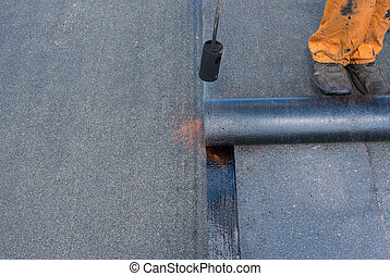 Professional installation of waterproofing - Roofer man...
