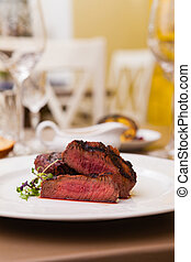 Filet mignon meal - Filet mignon served on a plate in...