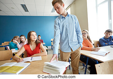 students gossiping behind classmate back at school
