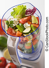 Vegetables in blender - Sliced fresh vegetables in blender...