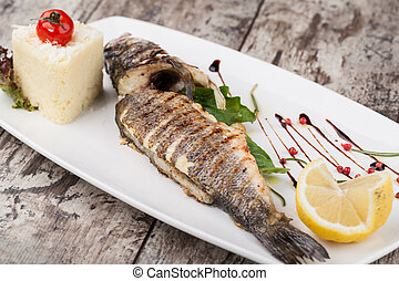 Grilled bream fish on a plate