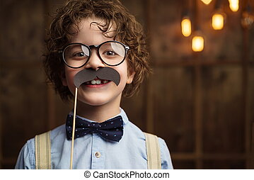 Hapiness - Smiling little hipster in studio